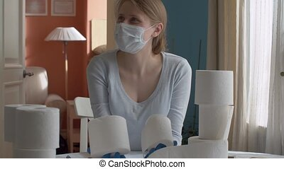 Smiling woman with toilet paper rolls in her hands