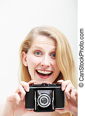 Smiling woman with vintage photo camera