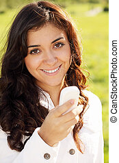 Smiling woman with white cellphone
