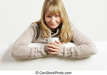 Smiling woman with white cup