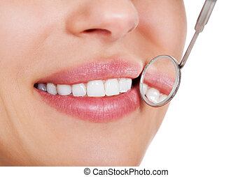 Smiling woman with white teeth - Cropped view of the mouth...