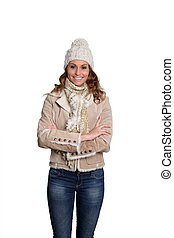 Smiling woman with winter clothes on white background