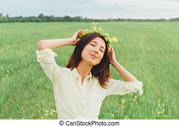 Smiling woman with wreath of flowers