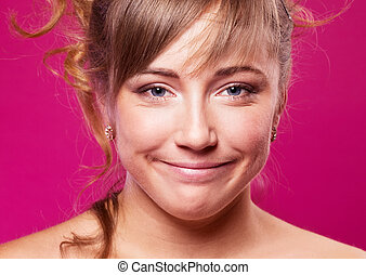 smiling woman - woman with a strained smile against pink ...