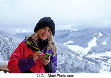 Smiling woman write a message in the mountains - Portrait of...