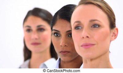 Smiling women looking away