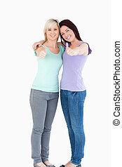 Smiling women posing