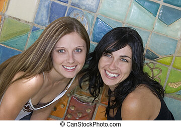 Smiling women friends