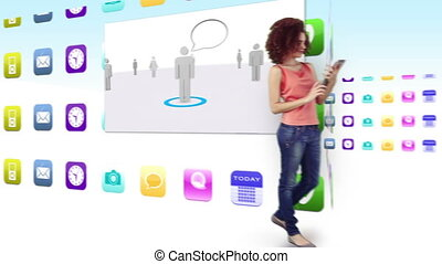 Smiling women using their tablet pcs on background of...