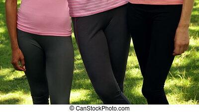 Smiling women wearing pink for brea