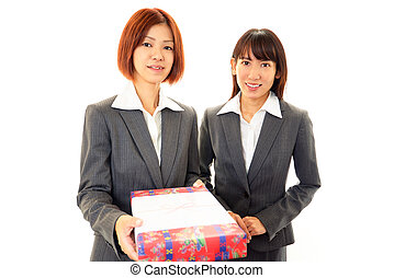 Smiling women with a gift