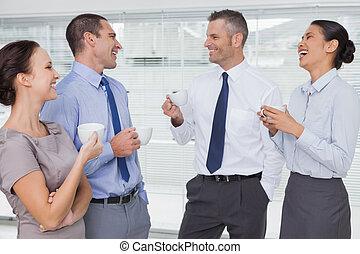 Smiling work team during break time