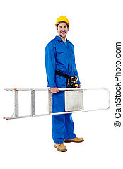 Smiling worker carrying a ladder