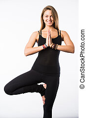 Smiling yoga girl on white background with palms touching in a gesture of namaste