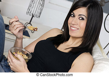 Smiling Young Adult Woman Eats Cereal With Fruit