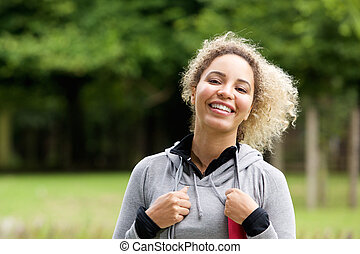 Smiling young african american sporty woman