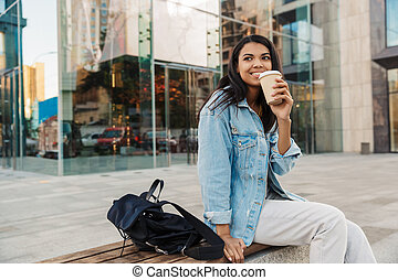 Smiling young african american woman sitting