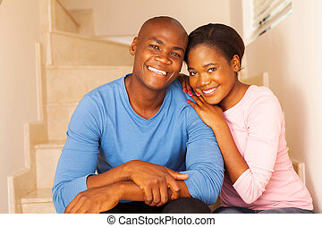 young african couple relaxing at home
