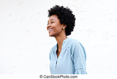 Smiling young african female against white background