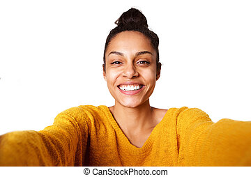 Smiling young african lady taking selfie