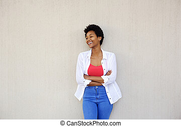 Smiling young african woman looking away