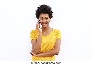 Smiling young african woman talking on cell phone
