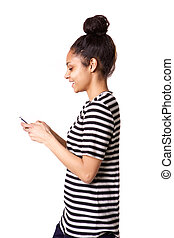 Smiling young african woman using cellphone