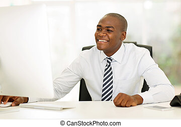young afro american businessman using computer