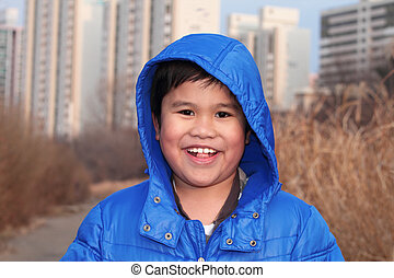 smiling young and happy boy portrait