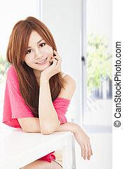 smiling young beautiful asian woman