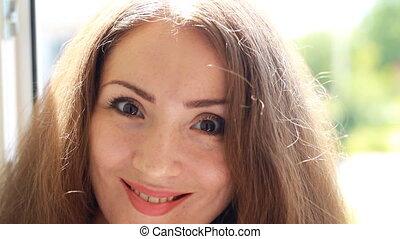 Smiling young beautiful woman closeup