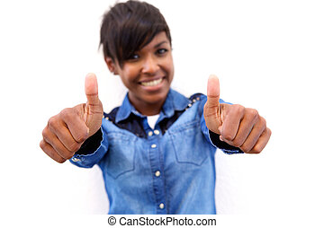 Smiling young black woman with thumbs up sign