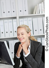 Smiling Young Blond Businesswoman In Office