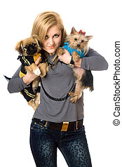 Smiling young blonde posing with two dogs