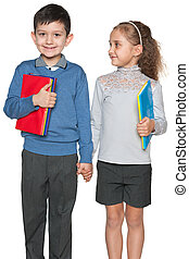 Smiling young boy and girl with books
