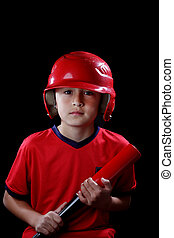 Smiling young boy with red baseball bat on black background