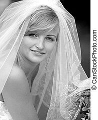 Smiling young bride in veil