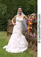 Smiling young bride poses
