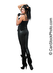 Smiling young brunette in black leggings. Isolated
