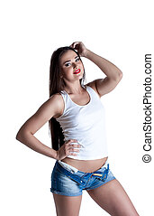Smiling young brunette posing in casual clothes