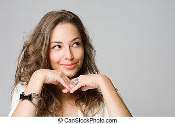 Smiling young brunette woman. - Closeup portrait of a...