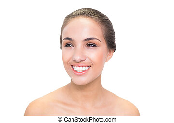 Smiling young brunette woman looking away