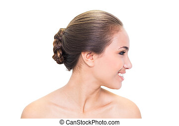 Smiling young brunette woman looking right