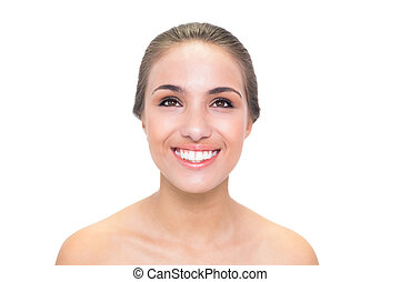 Smiling young brunette woman looking up