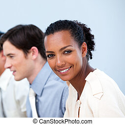 Smiling young business people at work