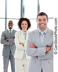 Smiling young business people in a row
