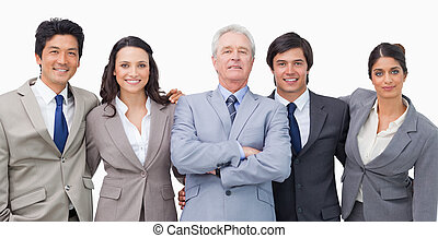 Smiling young business team with their mentor against a...