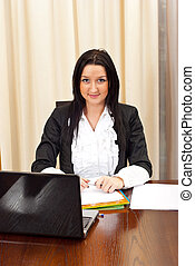 Smiling young business woman in  office