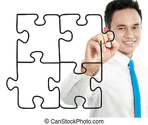 businessman drawing puzzle