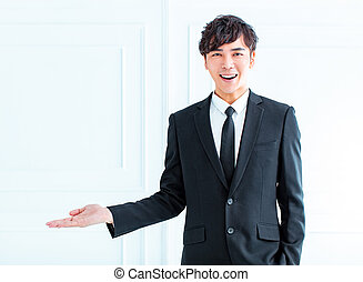smiling young businessman hand showing something